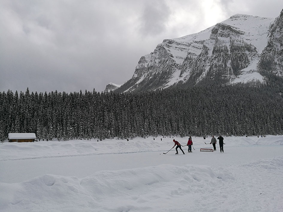 People playing hockey at the Lake Louise
